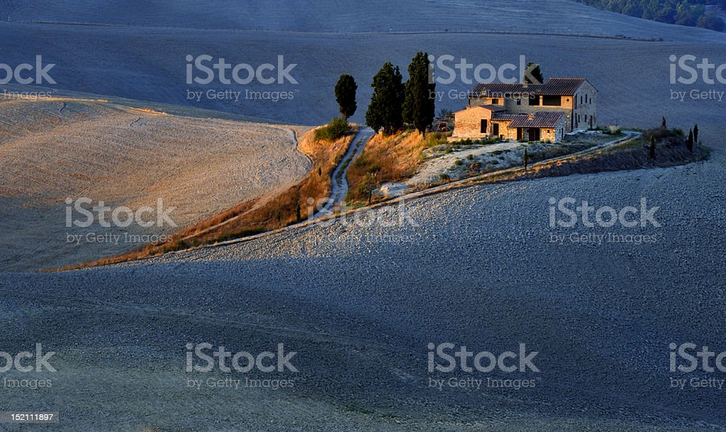 Tuscan Lonely Farmouse At Sunset stock photo