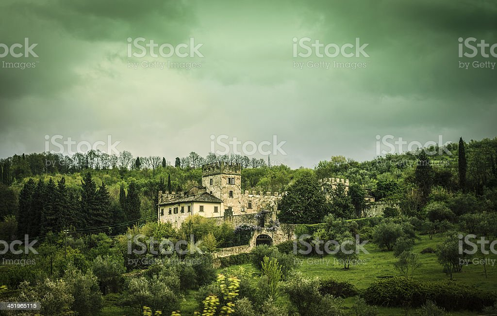 Tuscan mansion on the hill stock photo