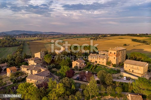 Tuscan village countryside from drone at sunset