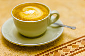 Cappuccino in a coffee bar in the Town of Montalcino in the Tuscany countryside of Italy