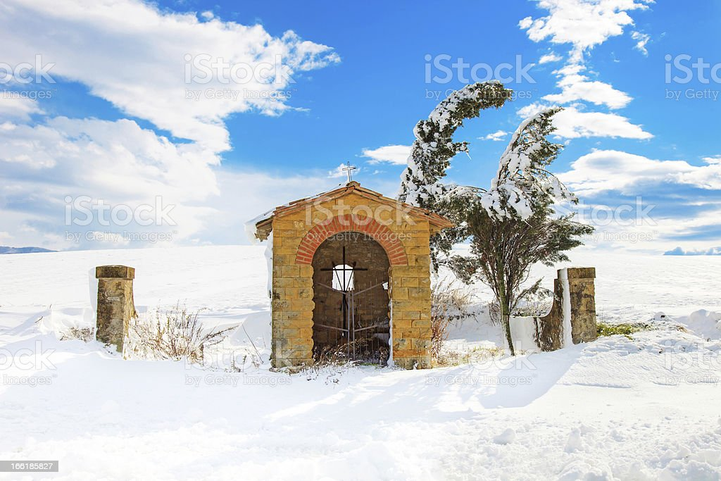 Tuscany, chapel and trees covered by snow in winter. Italy stock photo