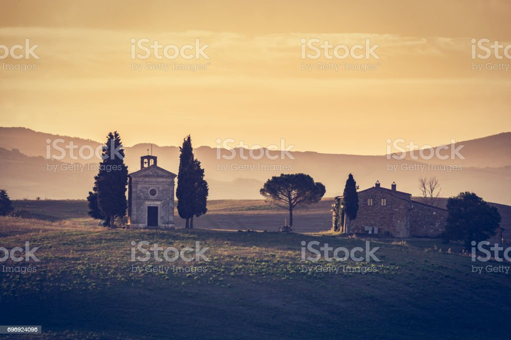 Tuscany landscape at sunrise. Chapel of Madonna di Vitaleta, San Quirico d'Orcia, Italy stock photo
