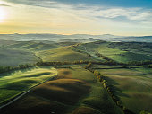 istock Tuscany landscape at sunrise with low fog 691930476