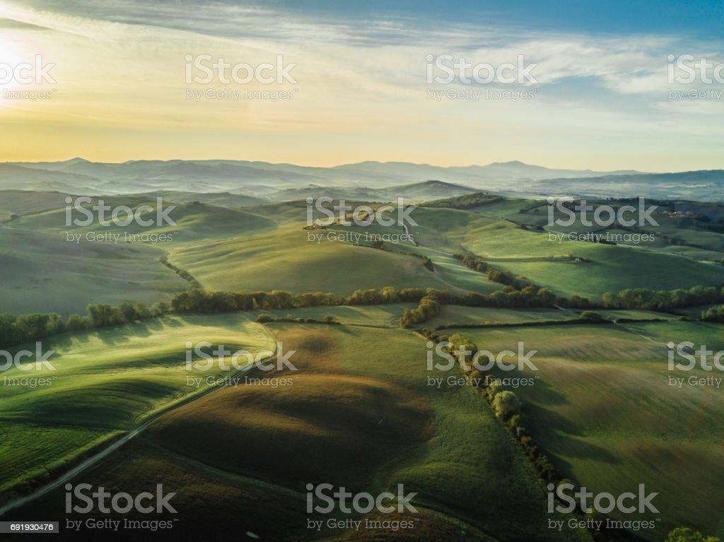 Tuscany landscape at sunrise with low fog stock photo