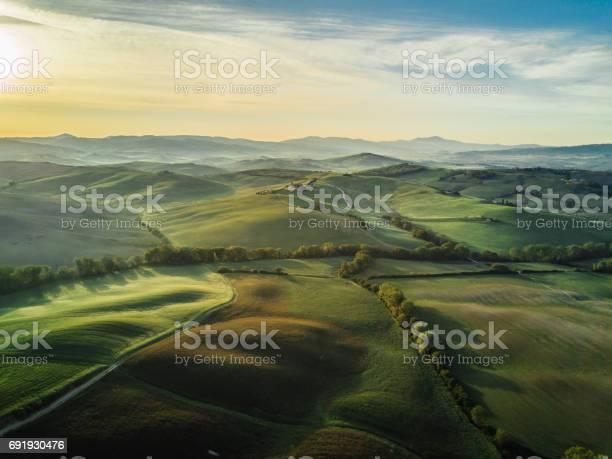 Photo of Tuscany landscape at sunrise with low fog