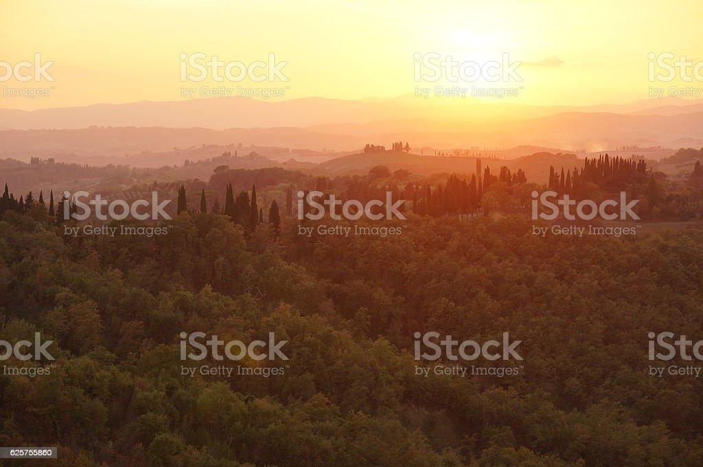 Tuscany landscape in warm sunset stock photo