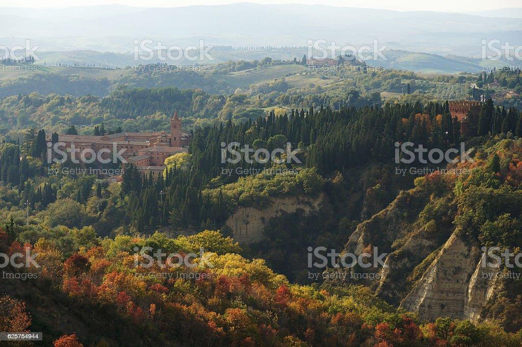 Tuscany landscape with monastery Monte Oliveto Maggiore stock photo