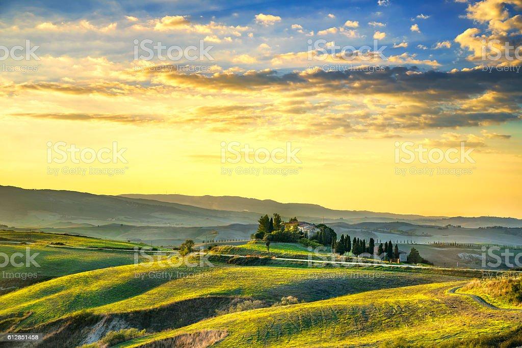 Tuscany Maremma sunset. Trees, farmlands, hills and fields. Volt stock photo
