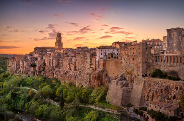 Tuscany, Pitigliano medieval village panorama sunset. Italy Tuscany, Pitigliano medieval village on tuff rocky hill. Panorama sunset. Italy, Europe. tuff stock pictures, royalty-free photos & images