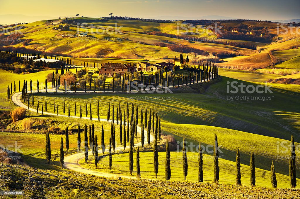 Tuscany, rural sunset landscape. Countryside farm, white road an stock photo
