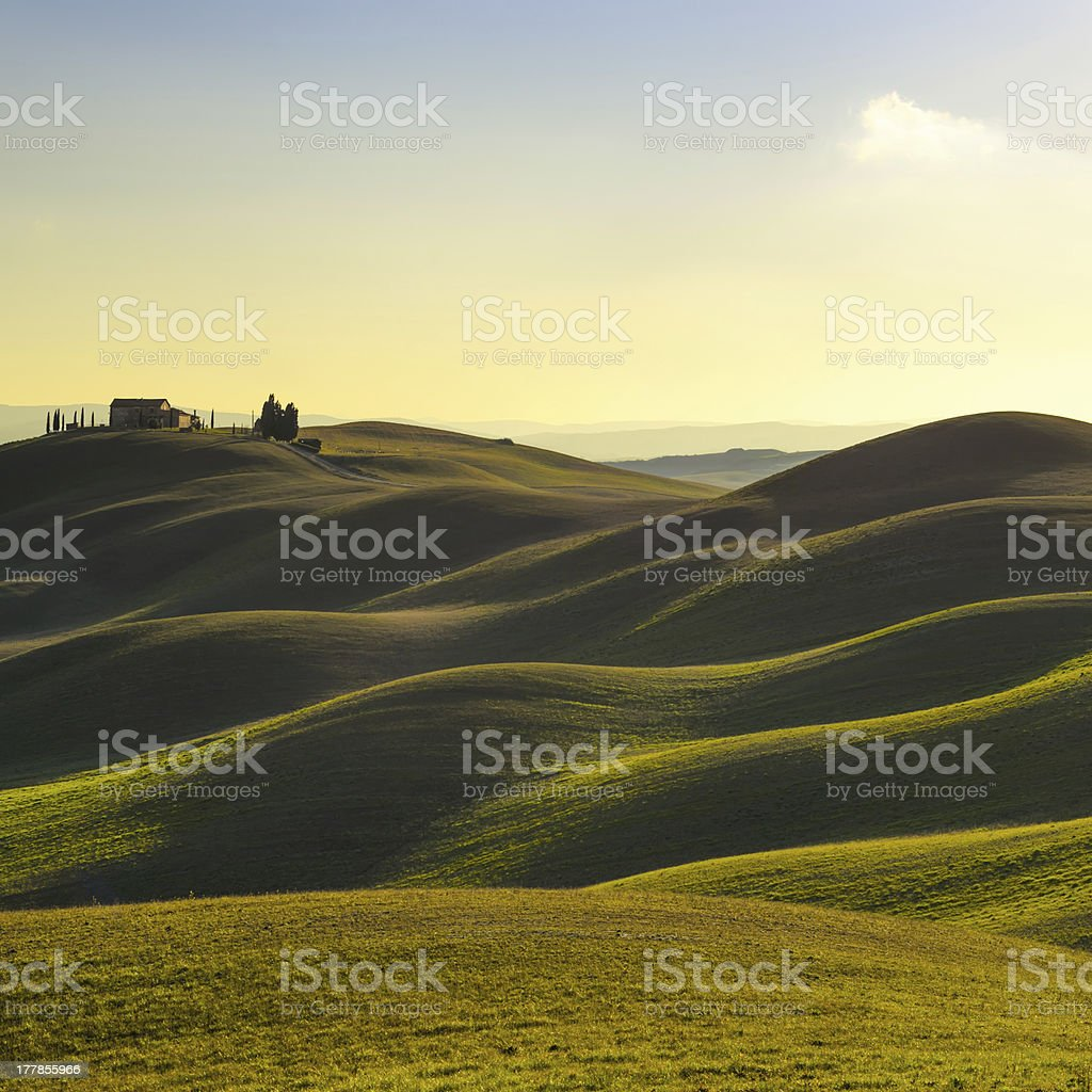 Tuscany, sunset rural landscape. Rolling hills, countryside farm, trees. stock photo