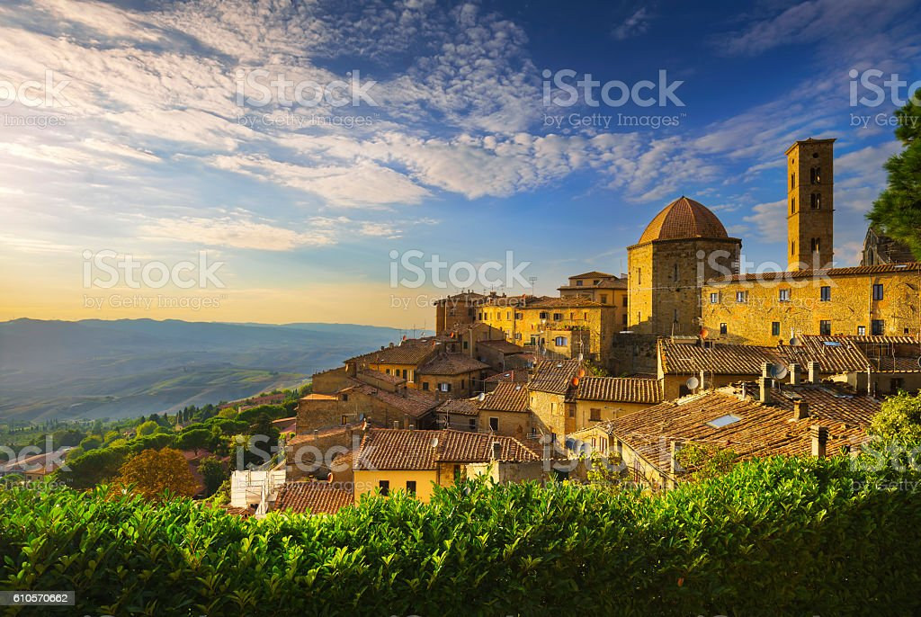 Tuscany, Volterra town skyline, church and panorama view on suns stock photo