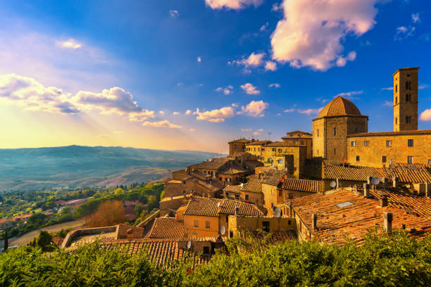 Tuscany, Volterra town skyline, church and panorama view on sunset. Italy stock photo