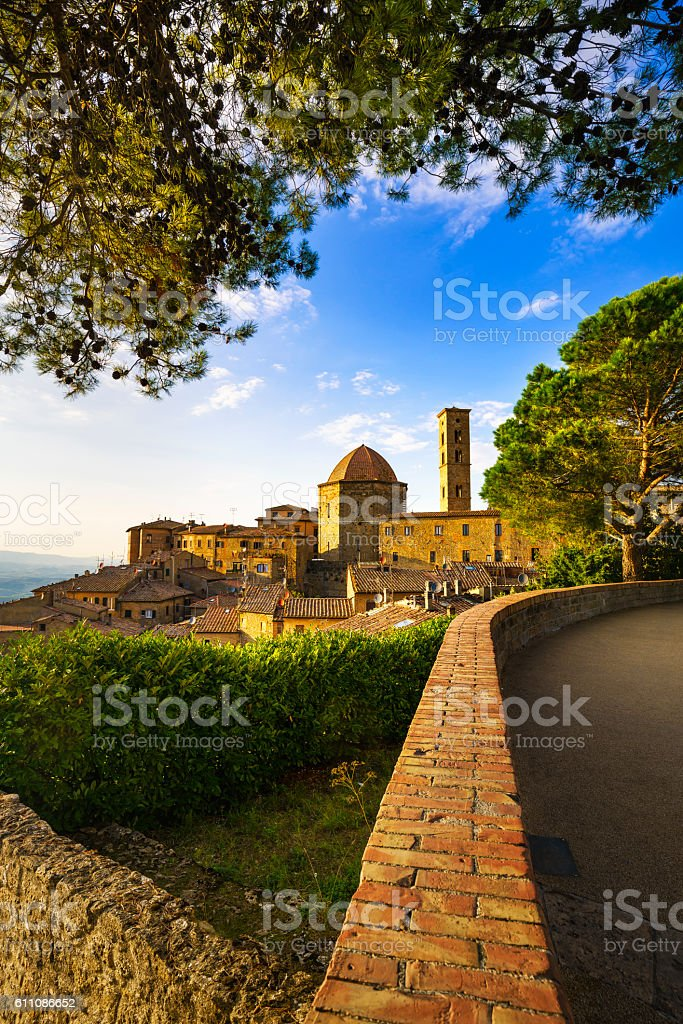 Tuscany, Volterra town skyline, church and trees on sunset. Ital stock photo
