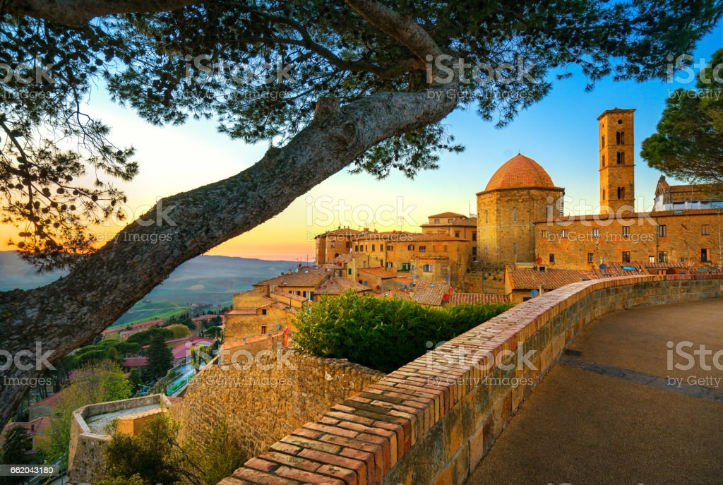 Tuscany, Volterra town skyline, church and trees on sunset. Italy stock photo