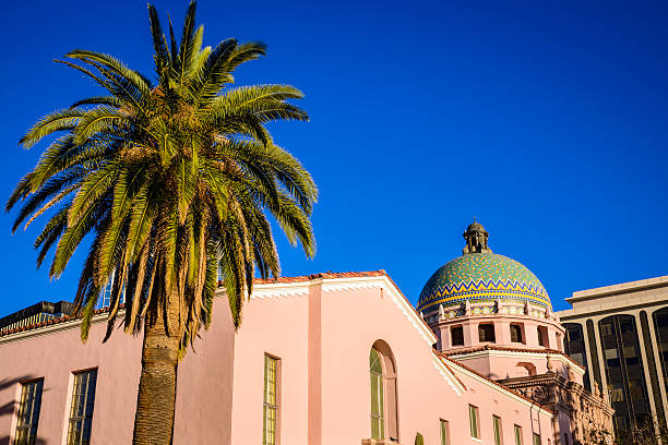 Tuscon Arizona Downtown Pima County Courthouse, palm tree, blue sky The Pima County courthouse in downtown Tucson, Arizona. pima county stock pictures, royalty-free photos & images