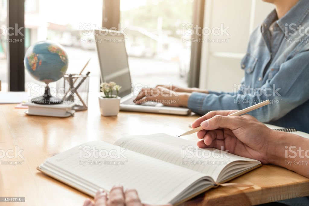 Tutor books with friends, Young students campus or classmates helps friend catching up workbook and learning tutoring in classroom, teaching, learning, People, technology, Education school concept royalty-free stock photo