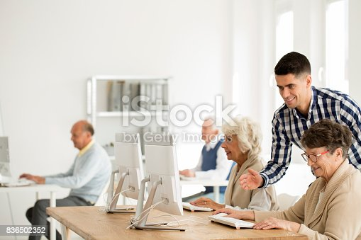 istock Tutor helping woman with computer 836502352