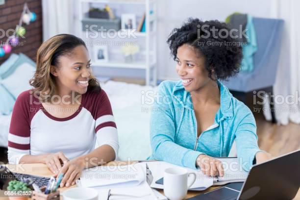 Tutor helps college girl with homework picture id668442852?b=1&k=6&m=668442852&s=612x612&h=fgvfo4jsy91eilvtonwevlnb fauy9onjaalwcrqco0=