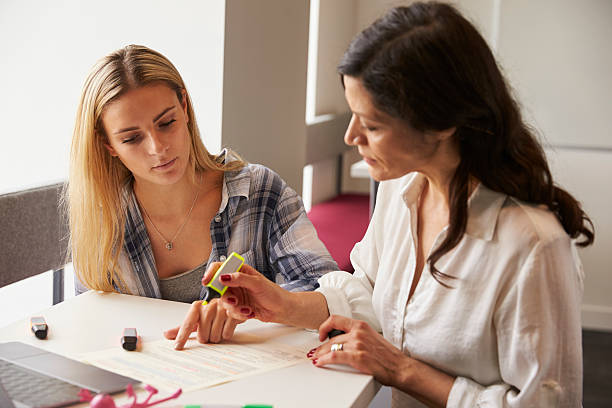 Tutor Using Learning Aids To Help Student With Dyslexia stock photo