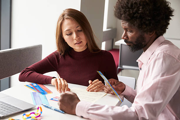 Tutor Using Learning Aids To Help Student With Dyslexia Tutor Using Learning Aids To Help Student With Dyslexia learning difficulty stock pictures, royalty-free photos & images