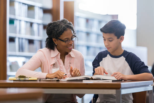 tutor working with middle school student - middle school teacher stock pictures, royalty-free photos & images