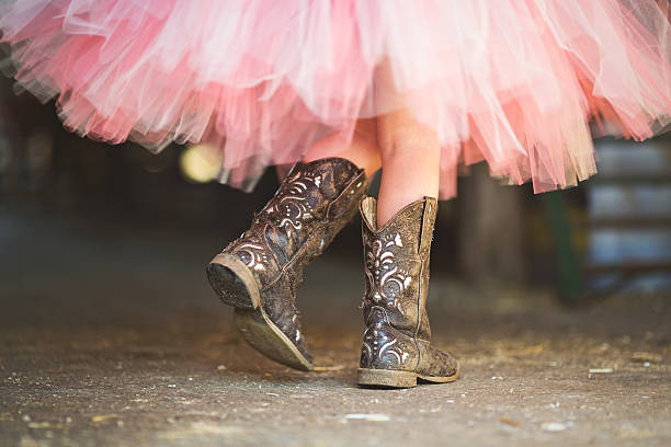 Tutu and Cowgirl Boots stock photo