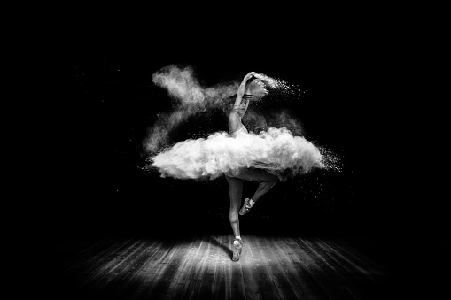 1042335572 istock photo Tutu from powder. Beautiful ballet dancer, dancing with powder on stage 1042335572