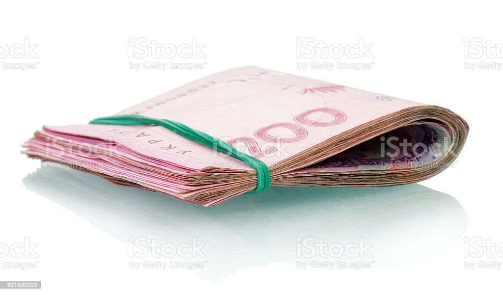 Tutu Ukrainian money fastened by rubber band isolated on white. photo libre de droits