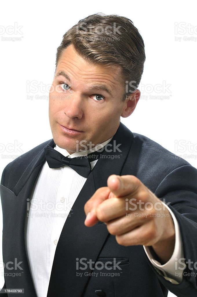 Tux man points finger stock photo