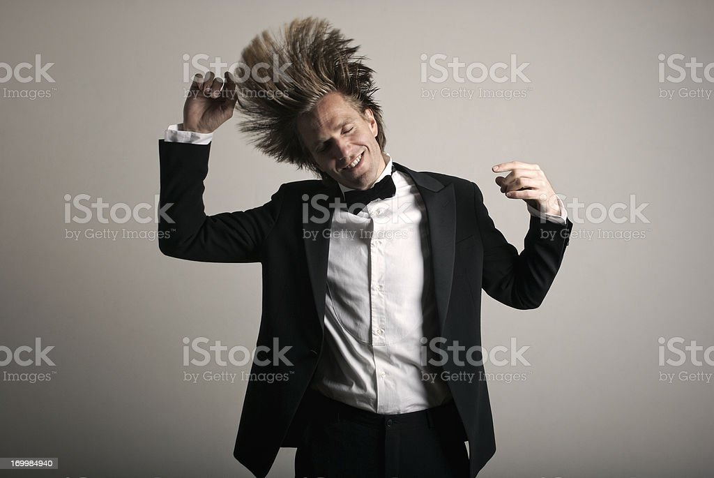 Tuxedo Man Celebrating Dancing at Party stock photo