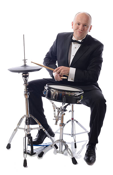 tuxedo playing drums man in tuxedo playing drums isolated on white drummer stock pictures, royalty-free photos & images