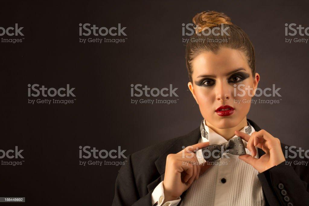 Tuxedo woman fixes his bow stock photo