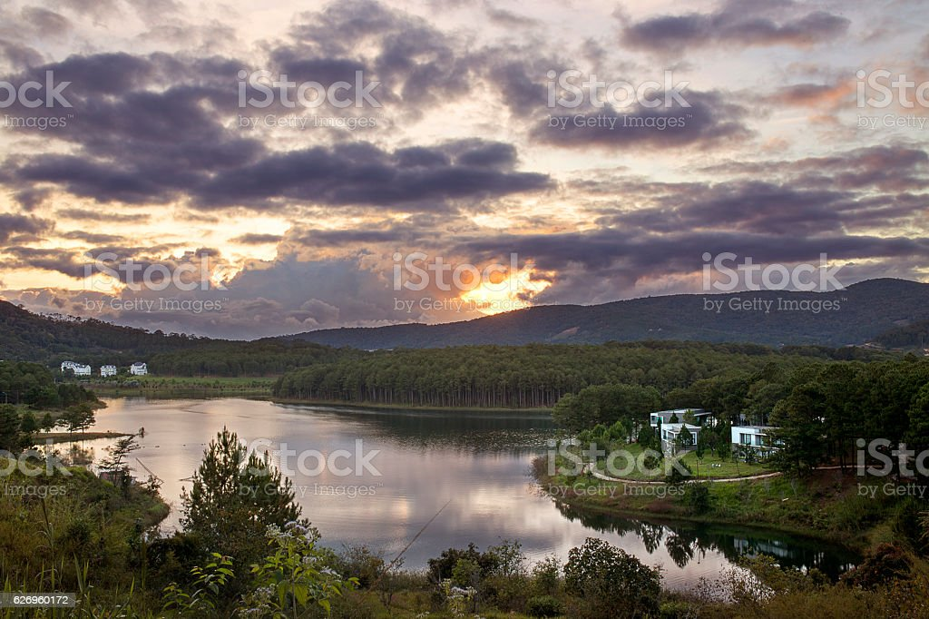 Tuyen Lam lake in a cloudy sunset stock photo