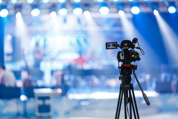 Tv camera in a concert hall Tv camera in a concert hall performance stock pictures, royalty-free photos & images