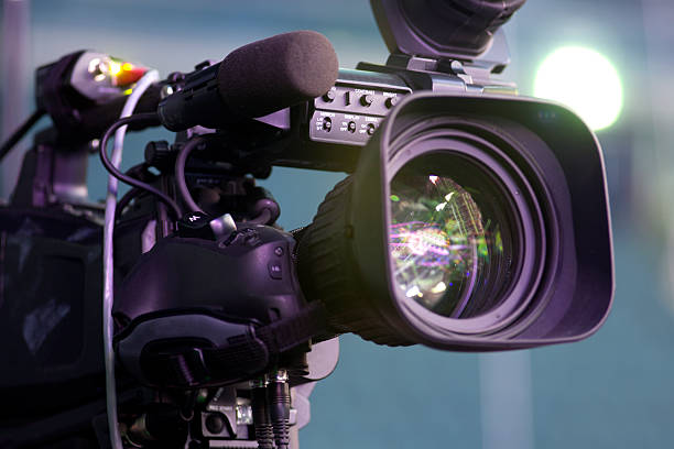 tv camera in a concert hall - camera photographic equipment stock photos and pictures