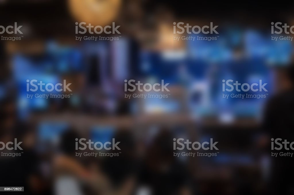 tv editor working with vision mixer panel at live concert. television engineer crew working with video & audio mixer for broadcasting event on stage in night club. blur background stock photo