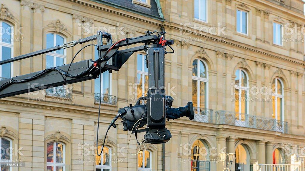tv movie camera crane jib set  production palace facade window stock photo