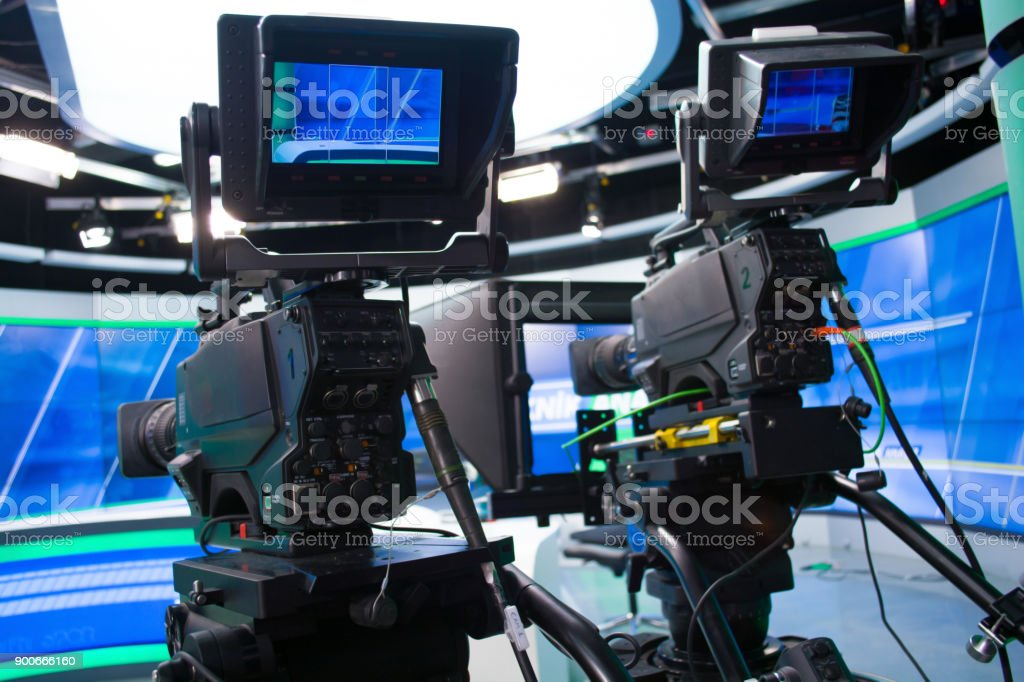 tv news studio with two camera and lights