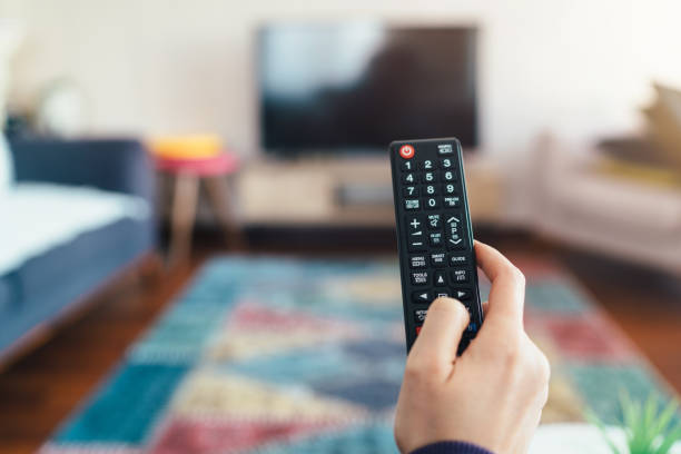 Tv remote Tv remote remote control stock pictures, royalty-free photos & images