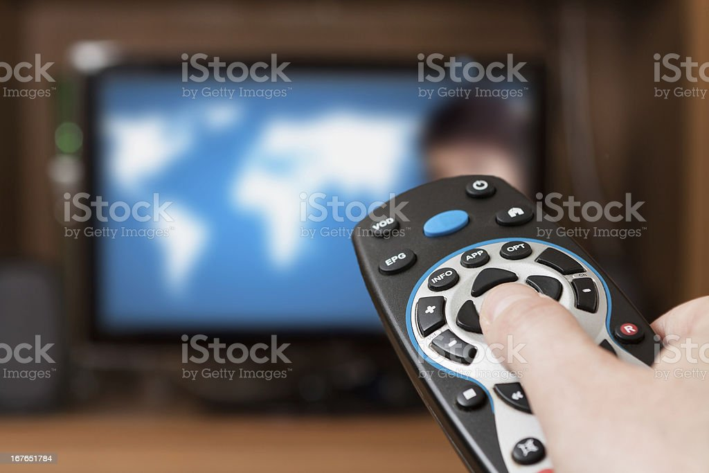 Tv remote with blurred tv background stock photo