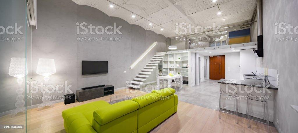 Tv room with green sofa stock photo