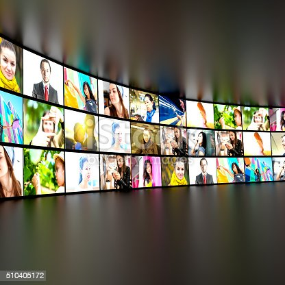 Digital Media - tv screens with video stills showing many people