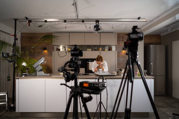 tv set studio kitchen female cook preparing cookies - camera photographic equipment stock pictures, royalty-free photos & images