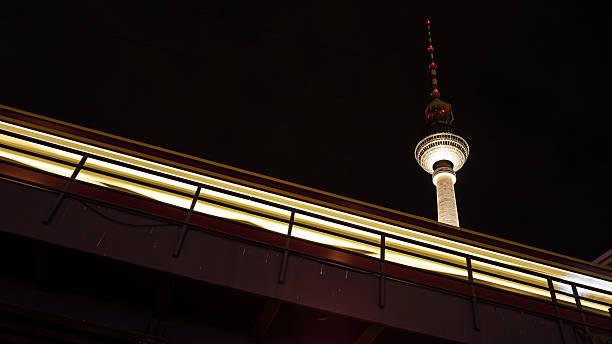 tv tower und zug in berlin - weltzeituhr stock-fotos und bilder