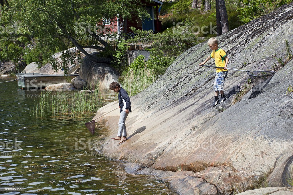 Tvo young boys with bag net. royalty-free stock photo
