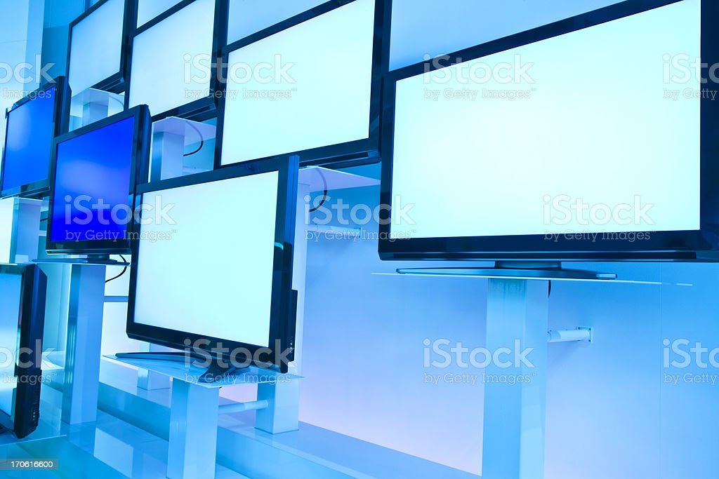 LCD TVs in a Row on Wall stock photo