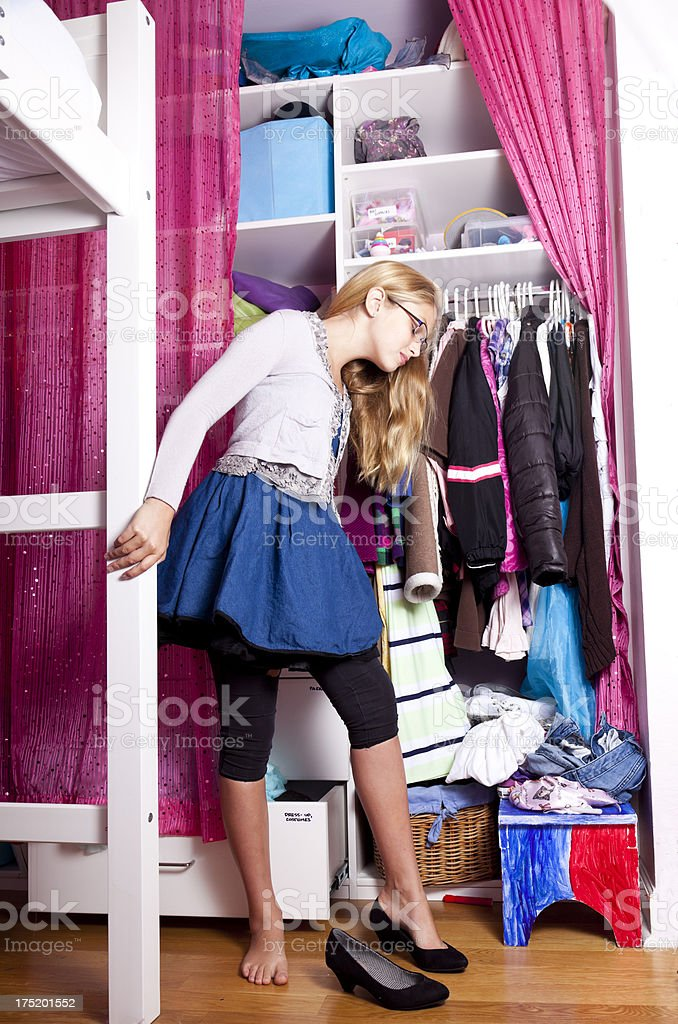 tween girl getting dressed royalty-free stock photo