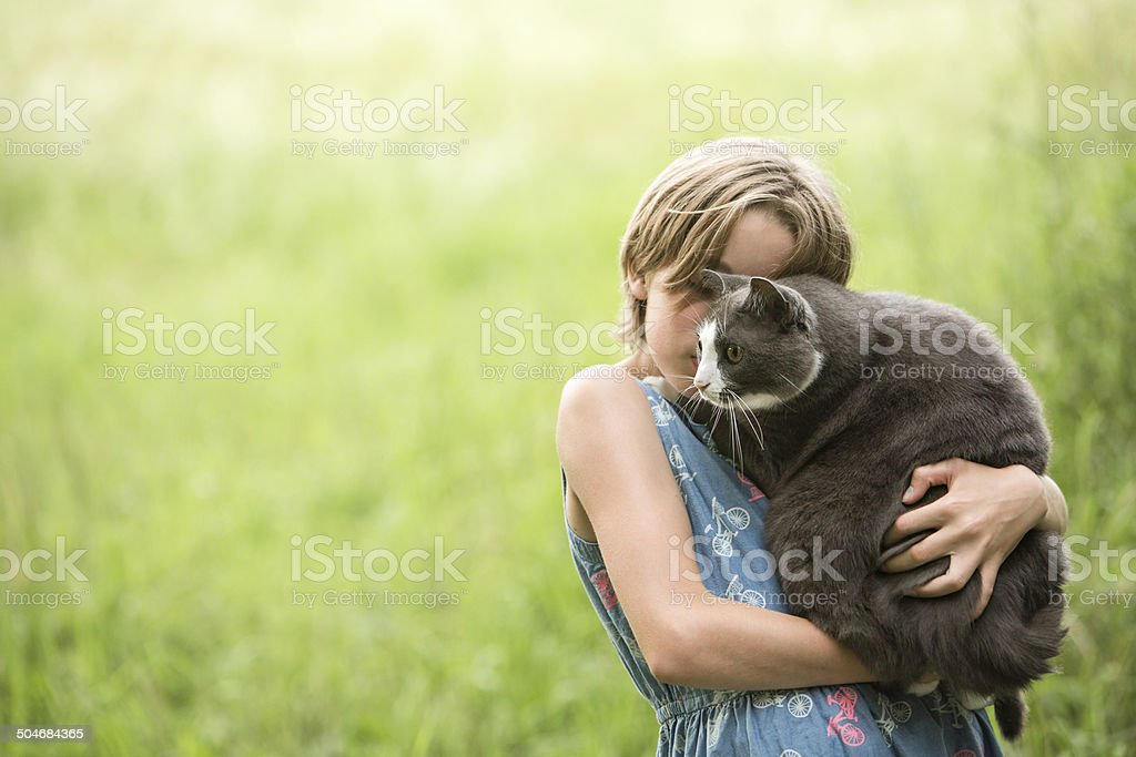 Tween Girl Holding Large Cat stock photo