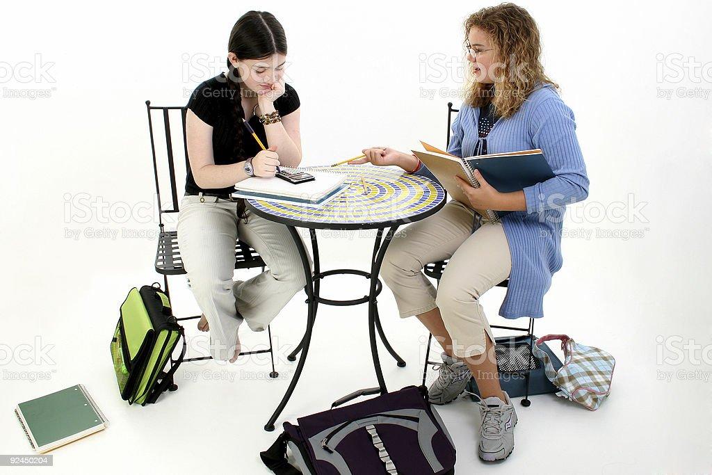 Tween Girls Doing Homework After School royalty-free stock photo